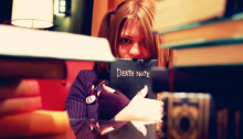 Woman holding Death Note book